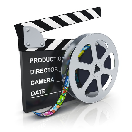 Cinema, movie, film and video media industry concept clapper board and reel with filmstrip with colorful pictures