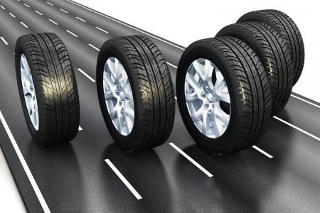 llantas: Creativo concepto automovil�stico industrial: conjunto de ruedas de coche negro de goma de auto conducci�n de la carretera carretera de asfalto aislada en el fondo blanco Foto de archivo