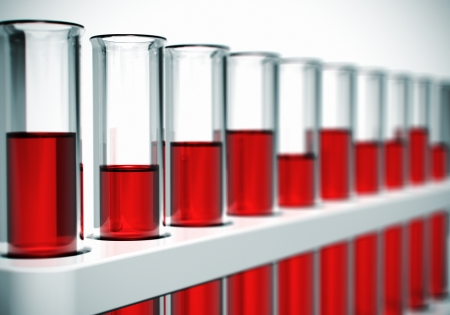 Glass laboratory chemical test tubes with red liquid or blood. Selective focus effect