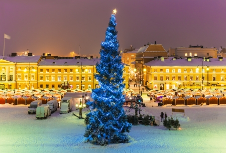 Winter night scenery of Senate Square with Christmas Tree and holiday market in Helsinki, Finland Stock Photo
