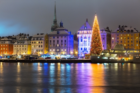 sweden: Night winter scenery of the Old Town (Gamla Stan) with Christmas Tree in Stockholm, Sweden