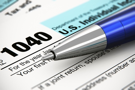 tax return: Tax form business financial concept  macro view of individual return tax form and blue metal ballpoint pen Stock Photo
