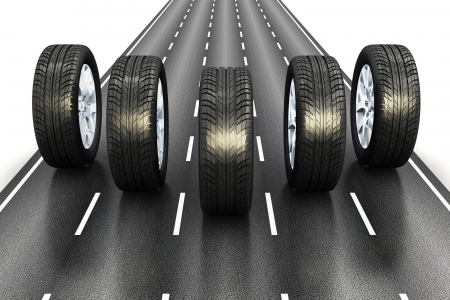 autobahn: Creative automotive industrial concept  set of black car auto rubber wheels driving the asphalt highway road isolated on white background