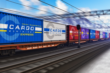 Freight train with color cargo containers passing railway station in winter with motion blur effect photo