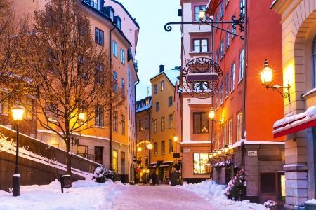 town houses capital: Evening winter scenery of street in Old Town (Gamla Stan)  in Stockholm, Sweden