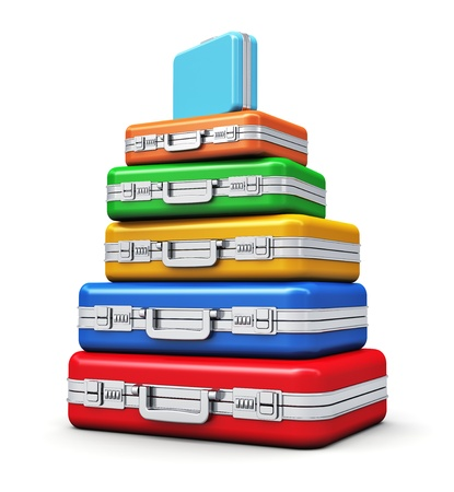 Stack of color travel cases isolated on white background photo