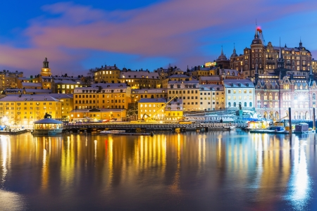 Beautiful winter night snowy scenery of Slussen district of the Old Town (Gamla Stan) in Stockholm, Sweden photo