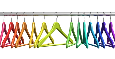 Row of color rainbow coat hangers on metal shiny clothes rail isolated on white background photo