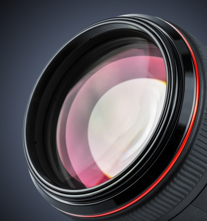 close up image: Macro of professional camera lens isolated on black background Stock Photo