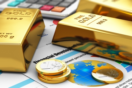 ingots: Business banking and financial success concept  gold ingots, coins and office calculator on colorful financial report documents with graphs, charts and stock market exchange data