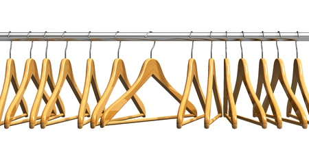 Row of coat hangers on metal shiny clothes rail isolated on white background photo