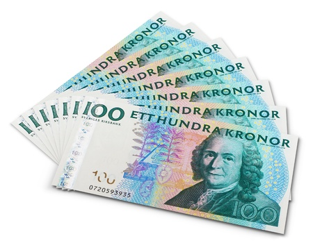 Stack of 100 swedish krona banknotes isolated on white background photo
