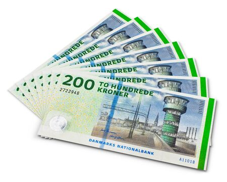 Stack of 200 danish krone banknotes isolated on white background photo
