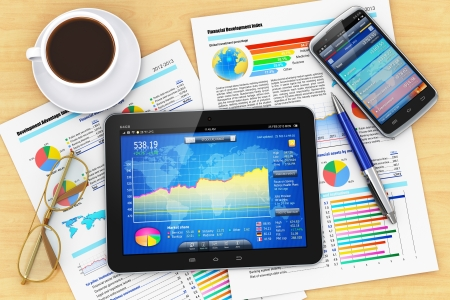 research paper: Modern business office workplace technology concept  tablet PC computer, black glossy touchscreen smartphone with stock market financial application, documents with financial reports, graphs and charts, ballpoint pen, eyeglasses and cup of coffee on woode