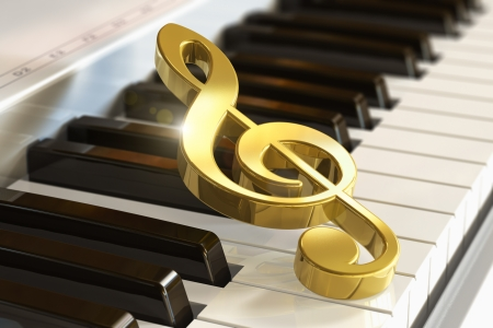 piano keyboard: Creative musical concept  macro view of golden shiny treble clef on piano or synthesizer keyboard with selective focus effect