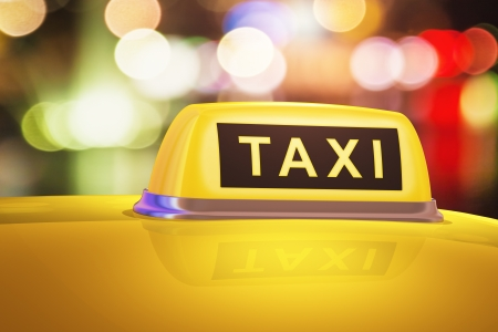 yellow taxi sign on car in evening or night city street outdoors