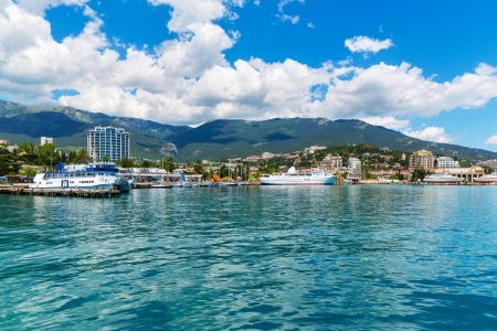 Scenic summer panorama of Black Sea pier and port harbor in Yalta, Crimea, Ukraine