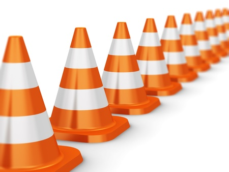 Row of orange traffic cones isolated on white background with selective focus effect