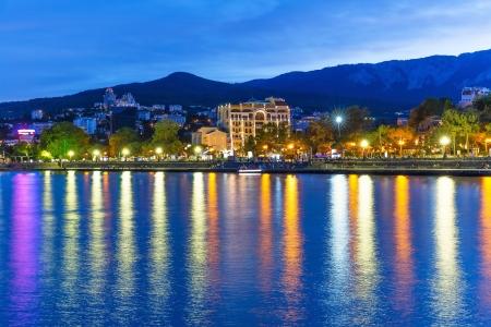 ukraine: Scenic summer evening panorama of Black Sea pier and port harbor in Yalta, Crimea, Ukraine