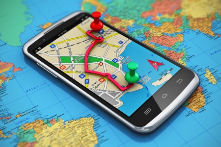 Mobile GPS navigation, travel and tourism concept  macro view of modern black glossy touchscreen smartphone with GPS navigation application, magnetic compass, pen and group of pushpins on world map with selective focus effect DESIGN IS MY OWN Stock Photo