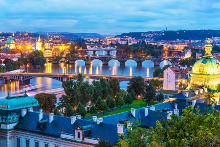 aerial view city: Evening summer scenery of the Old Town architecture with Vltava river and Charles Bridge in Prague, Czech Republic