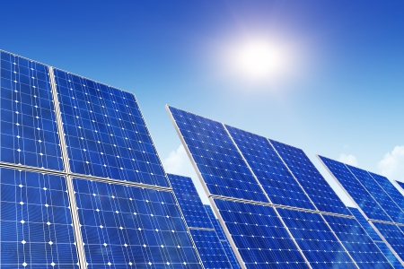 Creative solar power generation technology, alternative energy and environment protection ecology business concept  group of solar battery panels against blue sky with sun light Stock Photo - 22571542