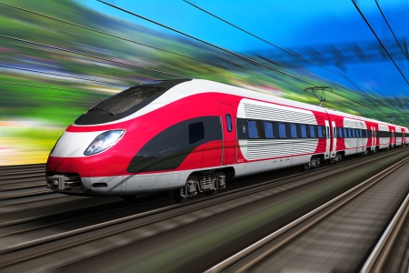 Railroad travel and railway tourism transportation industrial concept: scenic summer view of high speed passenger train on tracks with motion blur effect