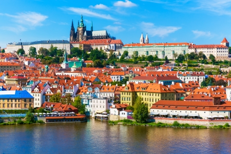 vltava: Scenic summer panorama of the Old Town architecture with Vltava river and St Vitus Cathedral in Prague, Czech Republic Stock Photo