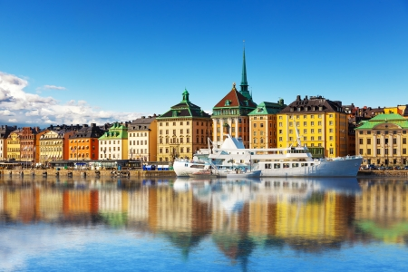 outdoor scenery: Scenic summer panorama of the Old Town  Gamla Stan  architecture pier in Stockholm, Sweden