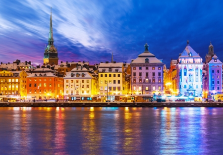 Beautiful winter scenery panorama of the Old Town  Gamla Stan  pier architecture in Christmas and New Year holidays in Stockholm, Sweden photo
