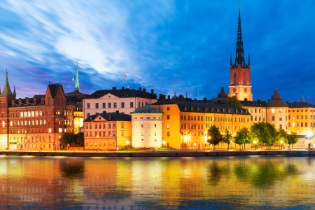 church building: Beautiful evening scenic panorama of the Old Town  Gamla Stan  pier architecture in Stockholm, Sweden Stock Photo