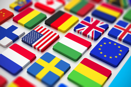 Creative abstract business, international communication and cartography technology corporate office concept close macro view of computer PC keyboard from colorful world countries flags with selective focus effect