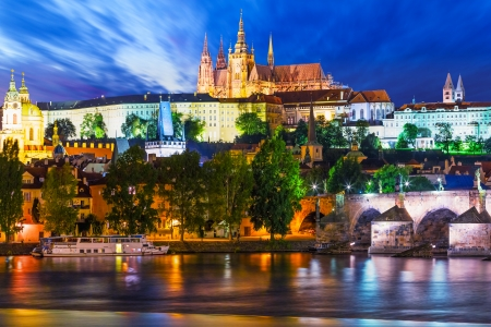 Scenic summer night panorama of the Old Town architecture with Vltava river and St Vitus Cathedral in Prague, Czech Republic photo