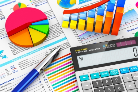 macro view of office electronic calculator, bar graph charts, pie diagram and ballpoint pen on financial reports with colorful data with selective focus effect Standard-Bild