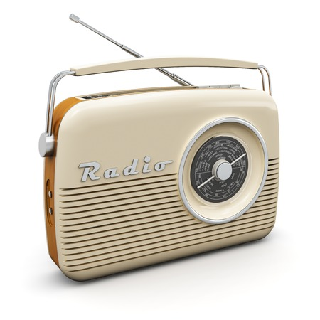 Old vintage retro style radio receiver isolated on white background Фото со стока