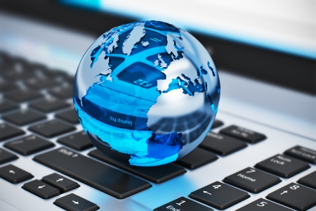 Creative abstract global communication and internet business telecommunication concept  macro view of crystal Earth globe on laptop or notebook keyboard with selective focus effect Stok Fotoğraf