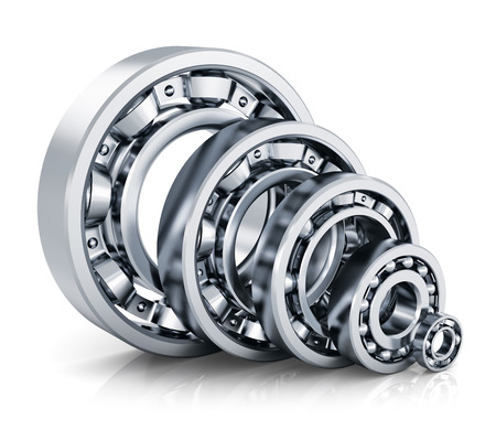 friction: Collection of different steel shiny ball bearings isolated on white background with reflection effect Stock Photo