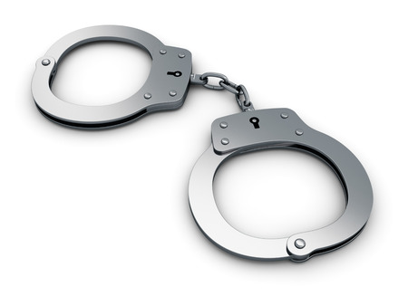 Metal handcuffs isolated on white background photo