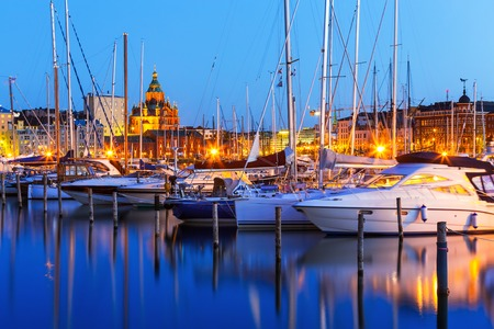 Scenic summer evening panorama of the Old Port and Uspenski Orthodox Cathedral in the Old Town in Helsinki, Finland photo