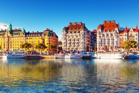 scandinavian landscape: Scenic summer panorama of the Old Town  Gamla Stan  pier architecture in Stockholm, Sweden