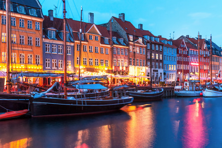 Scenic evening panorama of Nyhavn pier architecture in the Old Town of Copenhagen, Denmark