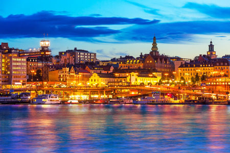scandinavian landscape: Beautiful evening scenic panorama of the Old Town  Gamla Stan  pier architecture in Stockholm, Sweden Stock Photo