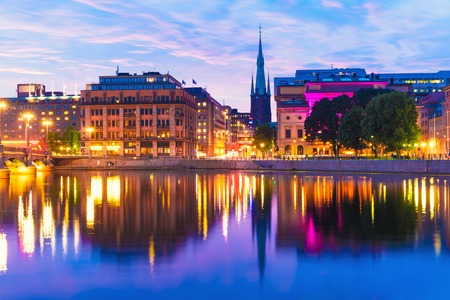 Beautiful summer evening scenery of sunset in the Old Town  Gamla Stan  architecture near the Vasa Bridge  Vasabron  in Stockholm, Sweden photo