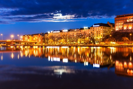 Scenic night panorama of sea pier in Hakaniemi district in Helsinki, Finland photo