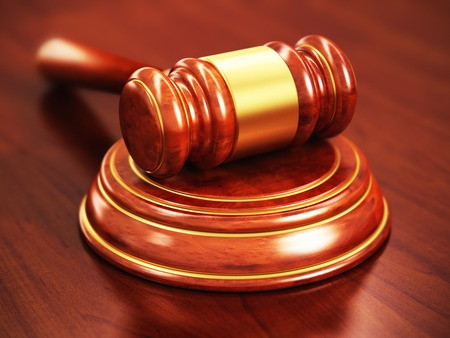 Creative law, justice and auction lot bidding business concept  macro view of wooden gavel, mallet or hammer with stand on wood office table with selective focus effect photo