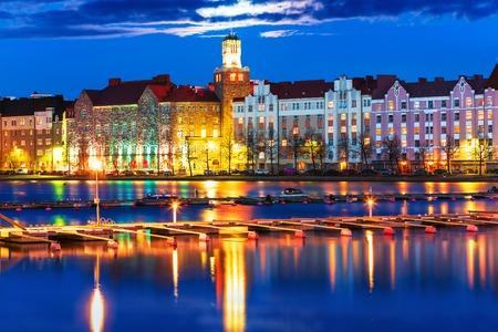 Scenic night panorama of sea pier illuminated architecture in Hakaniemi district in Helsinki, Finland photo