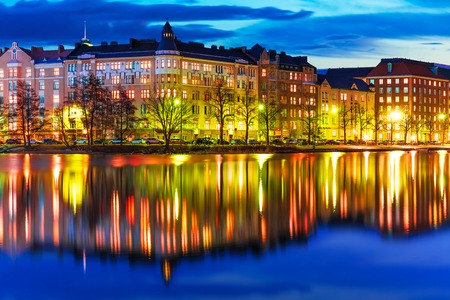 Scenic evening panorama of sea pier illuminated architecture in Hakaniemi district in Helsinki, Finland photo