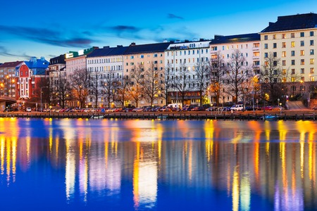 Scenic evening panorama of sea pier illuminated architecture in Hakaniemi district in Helsinki, Finland photo