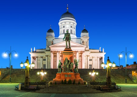 Famous landmark in Finnish capital  scenic night summer view of Senate Square with Lutheran cathedral and monument to Russian Emperor Alexander II photo