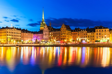 Scenic summer night panorama of the Old Town  Gamla Stan  architecture pier in Stockholm, Sweden photo